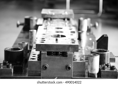 Stamping tool die. Monochrome image.