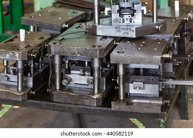 Stamping tool dies metal work stored on the machine-building plant.
