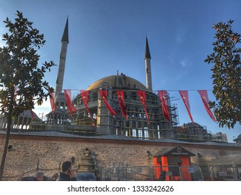 STANBUL, TURKEY - February 2019; New mosque construction in İstanbul Taksim. In the foreground is visible Monument commemorating Kemal Ataturk in Taksim Square in Istanbul