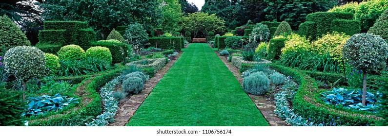 STANCOMBE PARK GARDEN, CLASSICAL ENGLISH LANDSCAPE GARDEN PARK, DURSLEY, GLOUCESTERSHIRE ENGLAND. JUNE 2015. This classical English landscape Park with it's imprssive long Upper Garden borders.