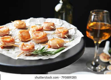 Stand with bacon wrapped scallops on table