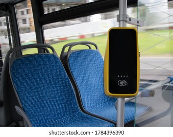 A stand with a bus payment terminal. Terminal for contactless payment of fare for ground public transport. Selective focus