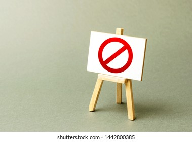Stand with a canvas and a red prohibition sign NO. Inability to sell products, ban on the import. Restriction on the importation of goods, proprietary for business. Seizure and freezing of assets