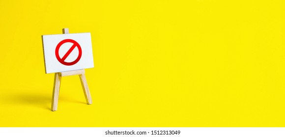 Stand with a canvas and a red prohibition sign NO. Restrictions, lifting the ban. proprietary for business. Full sale of goods, hot discounts. Important message. New rules and laws.