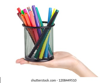 Stand for colour markers in hand on a white background. Isolation