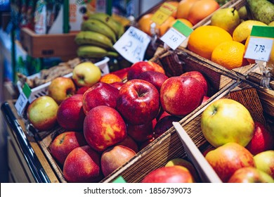 A stand of fresh fruit in the store. - Shutterstock ID 1856739073