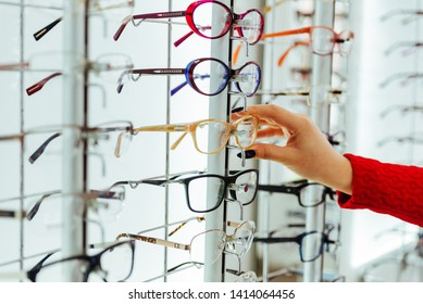 Stand with glasses in the store of optics eye concept