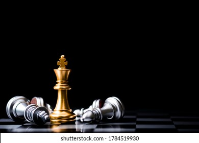 Stand of golden king chess and fallen silver king chess. Winner of business competition and marketing strategy planing concept.