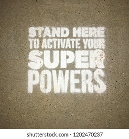 Stand Here to Activate Your Super Powers Painted Sidewalk Motivational Message