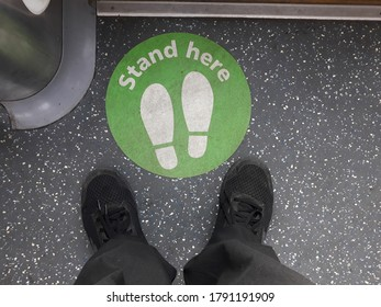 Stand here sign in train service found in Sydney, Australia. To maintain the social distance at public transport these sign are used to stop spread of Coronavirus.