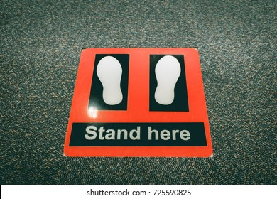 Stand here symbol in security checkpoint at airport.