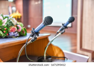Stand microphone in meeting room.