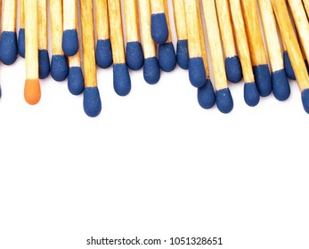 Stand out from the crowd. One match with an orange head in a pile of matches with blue heads. Matches isolated on white background. Space for text