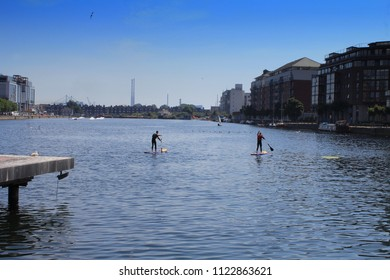 Stand up Paddle Boarding in Grand Canal Dock, Dublin, Ireland.