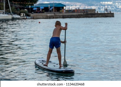 stand up paddle boarding on the sea