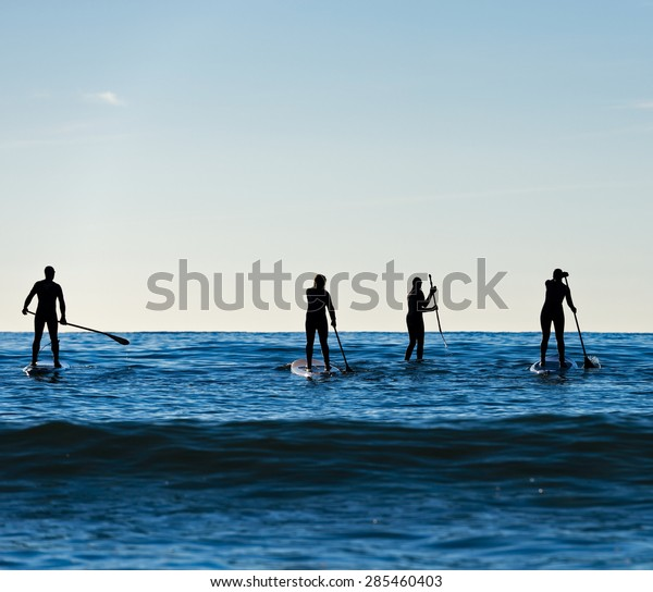 Stand up paddle boarding in Pacific surf
