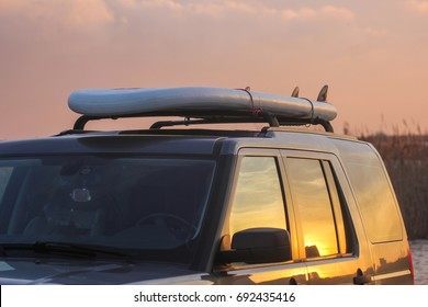 stand up puddle board (SUP) on the roof of the car