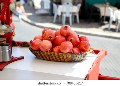 Stand selling fresh pomegranate juice on the streets of Akko (Acre)