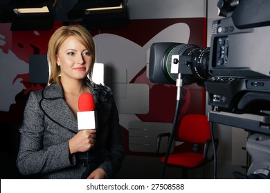 stand up transmission with serious smiling journalist woman in front of the video camera
