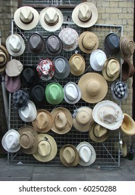 A stand with various hats in London street market.