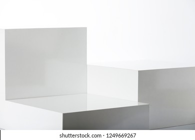 Stand, white cube boxes.