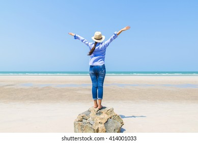 stand young woman on sea beach view point Relaxing and happy time Concept. with sea and sky background