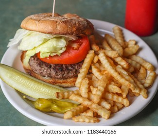 Standard American Hamburger served with crinkle fried and a dill pickle