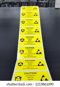 """Standard caution label with text """"Caution"""" for Electrostatic Sensitive Devices (ESD) in electronic industrial."""