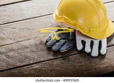 Standard construction safety equipment on wooden table and Light from the window