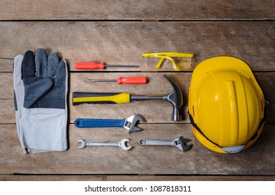 Standard construction safety equipment and tools set on old wooden background. top view, safety first concepts