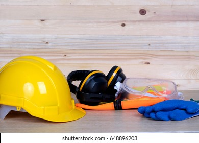 Standard construction safety on wooden background