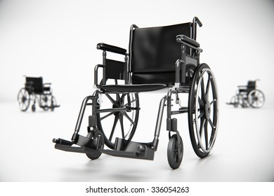 Standard manual wheelchair standing in white empty room