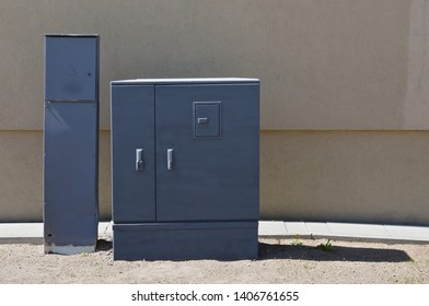 Standard  old  blue  street metal boxes  for counters of energy and the main power switches