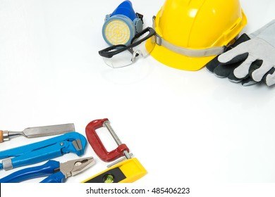 Standard safety tools and various working tools on white background.