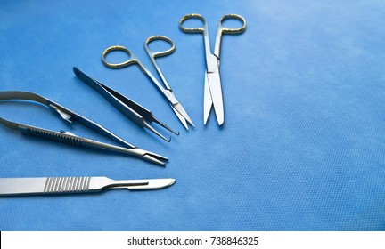 Standard surgical instruments on the blue sterilized blue wrap in hospital