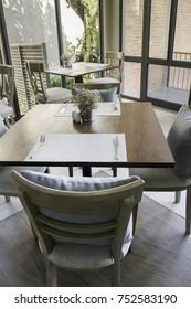 Standard table setting of hotel restaurant, stock photo