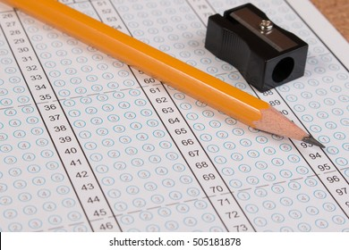 Standard test form or answer sheet. Answer sheet focus on pencil. Bubble answer sheet with blank answer. School exam answer sheet and pen.