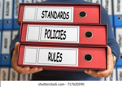 Standards, Policies, Rules, concept words. Folder concept. Ring binders.