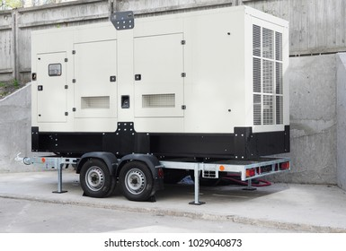 Standby generator. Industrial Power Diesel Generator Caravan.  Backup Generator Power.