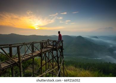 Standing Alone in Panguk Hill, berdiri sendiri di bukit panguk, mangunan imogiri jogjakarta, seeing a sunrise view in Yogyakarta