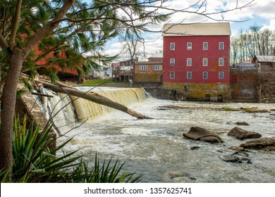 Standing along the banks looking at the Bridgeton Grist Mill in