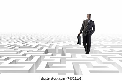 standing black man and 3d white maze