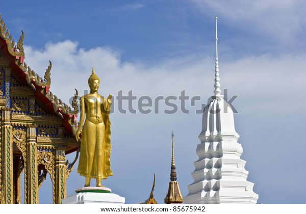 standing Buddha image with blue sky