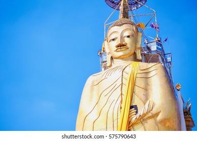 Standing Buddha Statue at Wat Intharawihan in Bangkok, Thailand