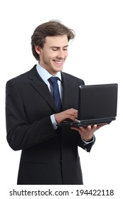 Standing business man browsing a laptop isolated on a white background