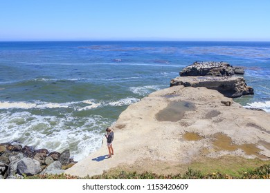 Standing by the California Coastline