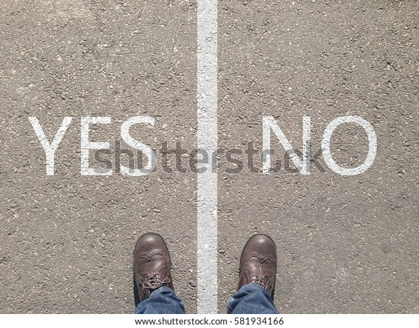 standing at the crossroad making decision which way to go - yes or no