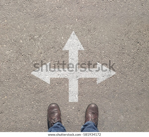 standing at the crossroad making decision which way to go - easy or hard