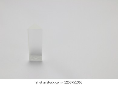 Standing Crystal triangular prism on white background