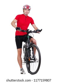 Standing cyclist holding his leg on a pedal